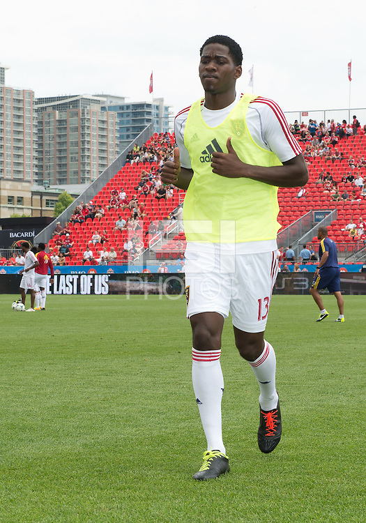 29 June 2013: Real Salt Lake forward Olmes Garcia #13 walks off the pitch after warm-ups during an MLS game between Real Salt Lake and Toronto FC at BMO Field in Toronto, Ontario Canada.<br /> Real Salt Lake won 1-0.