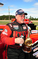 Mar. 12, 2012; Gainesville, FL, USA; NHRA top alcohol funny car driver Mickey Ferro celebrates after winning the Gatornationals at Auto Plus Raceway at Gainesville. The race is being completed on Monday after rain on Sunday. Mandatory Credit: Mark J. Rebilas-