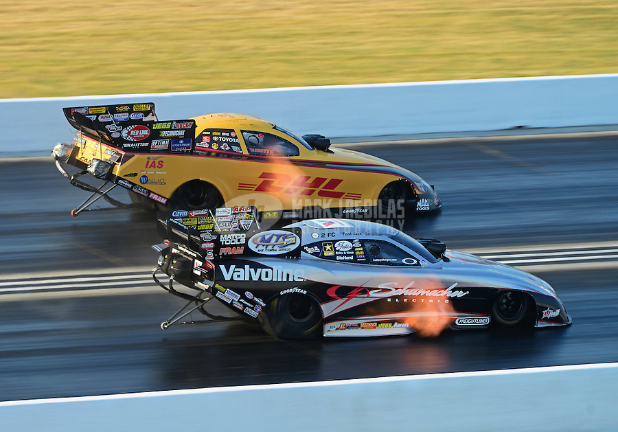 Jul. 1, 2012; Joliet, IL, USA: NHRA funny car driver Jack Beckman (near lane) races alongside Jeff Arend during the Route 66 Nationals at Route 66 Raceway. Mandatory Credit: Mark J. Rebilas-
