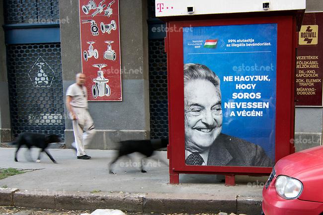 UNGARN, 07.2017, Budapest - VIII. Bezirk. Kampagne der Fidesz-Regierung gegen den US-ungarischen Juden, Finanzspekulanten und Foerderer einer offenen Gesellschaft, George Soros: &quot;Lassen wir nicht zu, dass Soros als Letzter lacht!&quot; Darueber in klein: &quot;99% (der Teilnehmer der Propaganda-Volksbefragung &quot;Nationale Konsultation&quot;) lehnen die illegale Einwanderung ab.&quot;  | Fidesz government campaign against the US-Hungarian jew, financial speculator and supporter of an open society, George Soros: &quot;Let's not Soros have the last laugh!&quot;. Small letters: &quot;99% (of the participants of the propaganda-referendum called &quot;national consultation&quot;) oppose illegal immigration.&quot;  <br /> &copy; Martin Fejer/estost.net