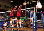 BROOKINGS, SD - SEPTEMBER 25:  Kelly Law #1 and Brittany Jessen #2 from the University of South Dakota try for the block on Makenzie Hennen #3 from South Dakota State University during their match Sunday afternoon at Frost Arena. (Photo by Dave Eggen/Inertia)