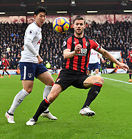 Tottenham Hotspur's Son Heung-Min (left) battles with Bournemouth's Simon Francis (right)<br /> <br /> Bournemouth 1 - 4 Tottenham Hotspur<br /> <br /> Photographer David Horton/CameraSport<br /> <br /> The Premier League - Bournemouth v Tottenham Hotspur - Sunday 11th March 2018 - Vitality Stadium - Bournemouth<br /> <br /> World Copyright &copy; 2018 CameraSport. All rights reserved. 43 Linden Ave. Countesthorpe. Leicester. England. LE8 5PG - Tel: +44 (0) 116 277 4147 - admin@camerasport.com - www.camerasport.com