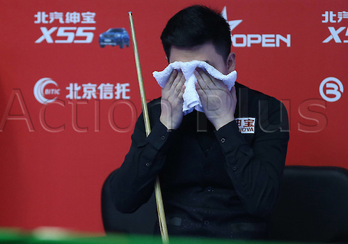 30.03.2016. Beijing, China.  Tian Pengfei of China reacts during the first round match against Barry Hawkins of England at the 2016 World Snooker China Open in Beijing,
