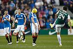 Darren McGregor kicks the ball into Kenny Miller's face