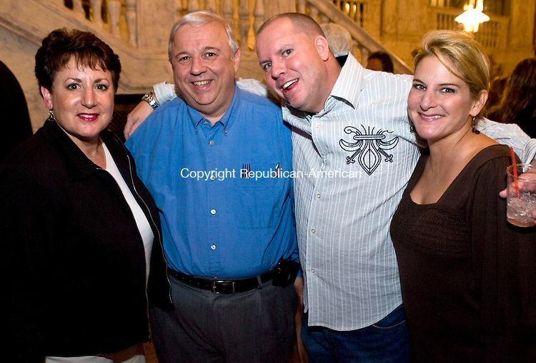 WATERBURY, CT - 13 NOVEMBER 2008 -111308JT10-<br /> From left, Joyce and Rocco Orso, of Waterbury, with Tom and Sue McGrenery, also of Waterbury, during the Palace Theater's pre-show VIP party before the Tower of Power show on Thursday, Nov. 13 in Waterbury. The event marked the start of the theater's annual fund campaign, and included the unveiling of a plaque honoring Domenic Temporale, who owned the Palace Theater from 1969 to 1998. The night's presentation of Tower of Power was sponsored in part by The Lombard Group. Porzio Chiropractic, The Law Offices of Thomas E. Porzio, LLC, All Star Transportation, The Durable Companies, Powerstation Events and The Worx Group. <br /> Josalee Thrift / Republican-American