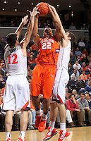 Clemson forward Bernard Sullivan (22) is defended by Virginia guard Joe Harris (12) and Virginia forward Evan Nolte (11) during the game Thursday in Charlottesville, VA.