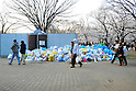 Tokyo, Japan - April 8: Garbage was thrown away in the middle of Yoyogi Park, Shibuya, Tokyo, Japan as many people had Hanami parties, or parties under cherry blossoms, on April 8, 2012. The garbage was seen several places in the park, and the amount got more and more as time went by..