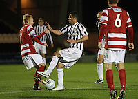 Lrewis Guy tackles Alister Crawford in the St Mirren v Hamilton Academical Scottish Communities League Cup match played at St Mirren Park, Paisley on 25.9.12.