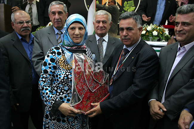 Palestinians take part in a ceremony honoring the chief of the general personnel council, Hussein al-Arja, in the building of Hebron governorate in the West Bank city of Hebron on May 3,2010. Photo by Najeh Hashlamoun
