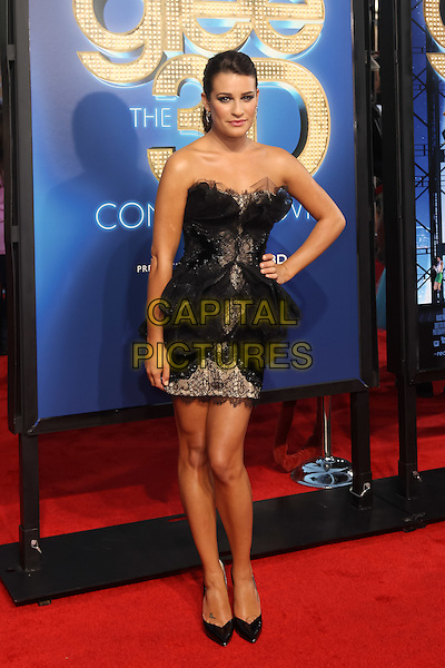 LEA MICHELE.The 20th Century Fox 'Glee 3D' Concert World Movie Premiere held at The Regency Village theatre in Westwood, California, USA,.August 6th 2011..full length dress strapless black hair up tulle lace tiered ruffles pointy shoes heels mini hand on hip .CAP/CEL.©CEL/Capital Pictures
