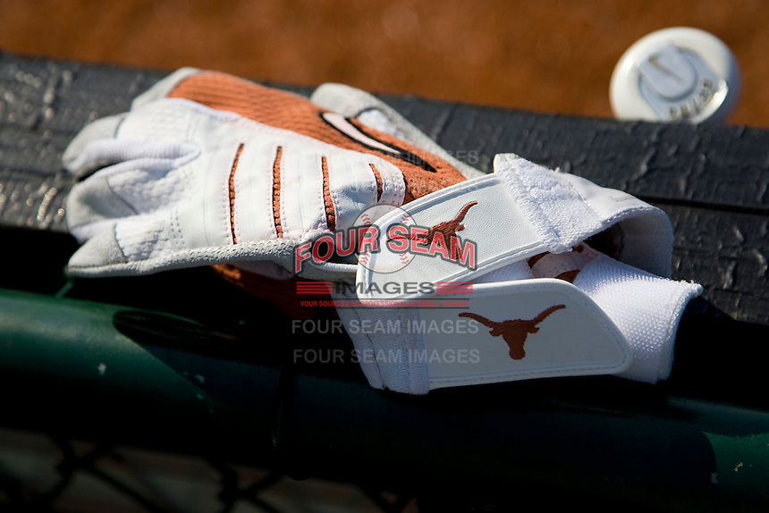 Texas Longhorn batting gloves on June 12, 2011 at Disch Falk Field in Austin, Texas. (Photo by Andrew Woolley / Four Seam Images)