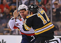 (Boston, MA  09/23/2013) Washington Capitals right wing Joel Rechlicz' face contorts as he takes a punch from Boston Bruins left wing Milan Lucic in the first period of their preseason game at TD Garden on Monday, September 23, 2013. Staff Photo by Matt West.