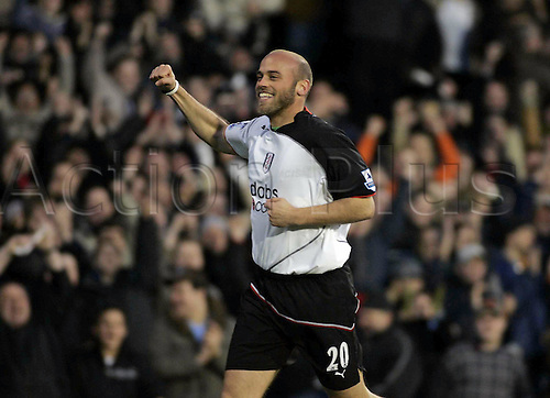 12 February 2005: Fulham midfielder CLAUS JENSEN celebrates scoring his goal during extra time in the FA Cup 4th Round game between Fulham and Derby County played at Craven Cottage. Fulham won the game 4-2 Photo: Action Plus...football soccer celebrate celebration joy celebrations 050212 player