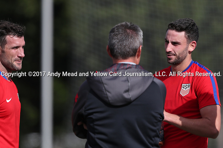11 January 2017: Steve Birnbaum (right) and Chris Pontius (left) talk with University of Maryland head coach Sasho Cirovski (center). The United States Men's National Team held their first training session under new head coach Bruce Arena on The Murphy Family Field at the StubHub Center in Carson, California.