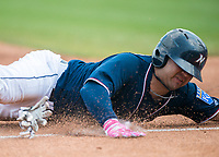 NWA Democrat-Gazette/CHARLIE KAIJO Northwest Arkansas Naturals catcher Luis Villegas (12) slides to third during a baseball game, Sunday, May 13, 2018 at Arvest Ballpark in Springdale.