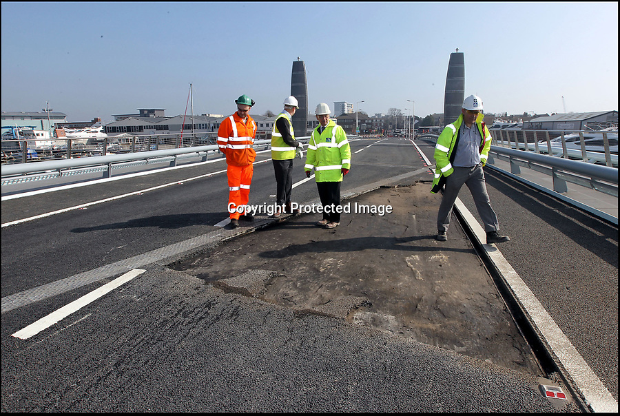 BNPS.co.uk (01202 558833)<br /> Picture by Richard Crease<br /> <br /> Bemused officials study the damaged bridge surface in February 2012<br /> <br /> Road to nowhere...Britain's worst bridge has closed yet again, and red faced council can only promise it will reopen in 'mid Autumn'.<br /> <br /> Bridge of sighs - A £37million bridge which has endured a litany of mishaps is now out of action again - until the mid-Autumn.<br /> <br /> The Twin Sails Bridge in Poole, Dorset, which is currently stuck in an upright position, has been plagued by numerous technical faults since it was unveiled amid much fanfare in 2012.<br /> <br /> It was previously out of action in November and December of last year, and for two weeks in February. <br /> <br /> The latest closure is a further blow to locals as the Sandbanks Ferry, which covers a 250ft stretch of water between Sandbanks and Studland, has been shut since July and will not run again until October - forcing motorists to make a 25 mile detour.<br /> <br /> It has sparked outrage on social media, with some labelling it an 'expensive white elephant'.