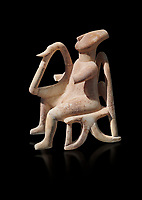 The 'Harpist of Keros' a seated parian marble female Cycladic figurine. Early Cycladic Period II (2800-2300 BC) from Keros, Cat no 3908. National Archaeological Museum, Athens. Black background.<br /> <br /> This elaborate three dimesional Cyladic statue known as the 'Harpist of Keros' depicts a seated figure plaung a harp. Its execution required an experienced workshop that could file away the parian marble with gronze tools.