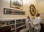Chief of the Boat David Stephenson and MMI Keith Kaiser talk in Gov. Brian Sandoval's office following the USS Nevada Centennial of Launch ceremony at the Capitol, in Carson City, Nev., on Friday, July 11, 2014. Sandoval has a number of historical USS Nevada items, including the ship's wheel, displayed in his office.<br /> Photo by Cathleen Allison