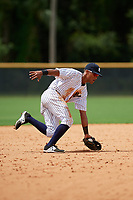 GCL Yankees East shortstop Ricky Surum (20) fields a ground ball during the second game of a doubleheader against the GCL Blue Jays on July 24, 2017 at the Yankees Minor League Complex in Tampa, Florida.  GCL Yankees East defeated the GCL Blue Jays 7-3.  (Mike Janes/Four Seam Images)