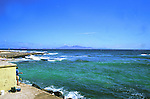 View of Lanzarote across the sea from Corralejo, Fuerteventura, Canary Islands.