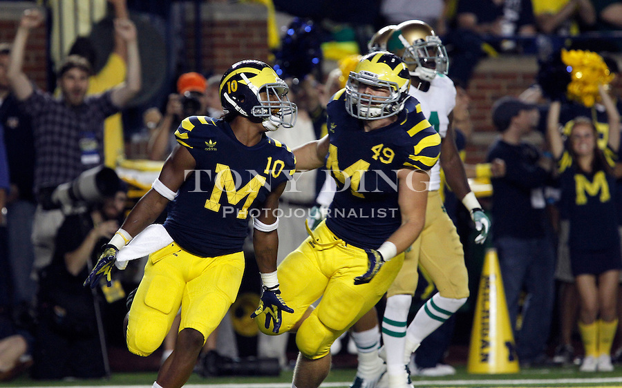 Michigan wide receiver Jeremy Gallon (10) celebrates his touchdown with fullback John McColgan (49) in the fourth quarter of an NCAA college football game against Notre Dame, Saturday, Sept. 10, 2011, in Ann Arbor. Michigan won 35-31. (AP Photo/Tony Ding)