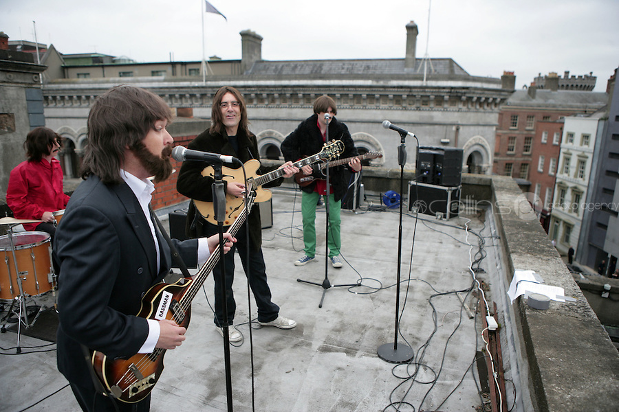 NO FEE PICTURES.10/6/10 John, Paul, Ringo and George at a photocall on the rooftop of the Olympia Theatre to Celebrate Get Back: The Story of The Beatles debut at the Olympia Theatre from Wednesday 4th August untill Sunday August. Arthur Carron/Collins