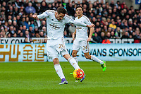 Gylfi Sigurdsson of Swansea City takes a shot on goal during the Barclays Premier League match between Swansea City and Southampton  played at the Liberty Stadium, Swansea  on February 13th 2016