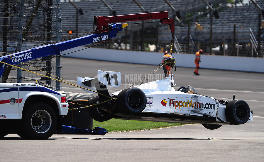 May 28, 2010; Indianapolis, IN, USA; The crashed car of Indy Light Series driver Pippa Mann is towed off the track during the Freedom 100 at the Indianapolis Motor Speedway. Mandatory Credit: Mark J. Rebilas-