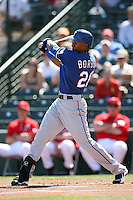 Julio Borbon #20 of the Texas Rangers plays in a spring training game against the Los Angeles Angels at Tempe Diablo Stadium on March 8, 2011  in Tempe, Arizona. .Photo by:  Bill Mitchell/Four Seam Images.