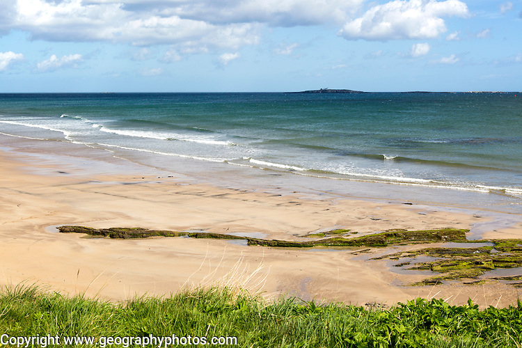 Wide sandy beach at Seahouses, Northumberland, England,UK