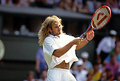 27 June 1992: American tennis player Andre Agassi during warm up before a match in The Wimbledon Championships 1992 without his customary headband. <br />