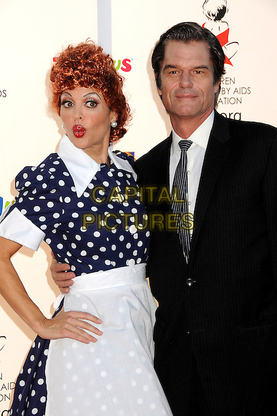 LISA RINNA & HARRY HAMLIN .17th Annual Dream Halloween Benefit for the Children Affected by Aids Foundation held at Barker Hangar, Santa Monica, California, USA, .30th October 2010..half length fifties polka dot dress white apron blue red hair wig married couple husband wife suit tie hand on hip pouting funny costume dressed up .CAP/ADM/BP.©Byron Purvis/AdMedia/Capital Pictures.