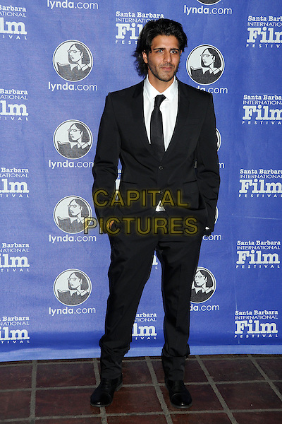 "Jay Ali.27th Annual Santa Barbara Film Festival Opening Night Premiere of ""Darling Companion"" held at the Arlington Theatre, Santa Barbara, California, USA..January 26th, 2012.SBFF full length hands in pockets black white tie stubble facial hair .CAP/ADM/BP.©Byron Purvis/AdMedia/Capital Pictures."