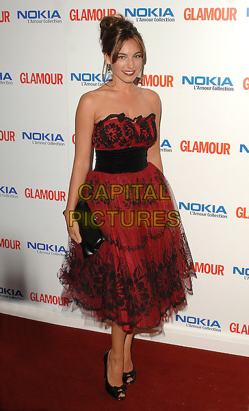 KELLY BROOK.attending the Glamour Women Of The Year Awards, Berkeley Square Gardens, London, 5th June 2007..full length strapless red and black vintage style fifties prom waistband peep-toe shoes.CAP/BEL.©Tom Belcher/Capital Pictures.