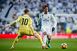 Raphael Varane (R) of Real Madrid battles for the ball with Samuel Castillejo Azuaga, Samu Castillejo, of Villarreal CF during the La Liga 2017-18 match between Real Madrid and Villarreal CF at Santiago Bernabeu Stadium on January 13 2018 in Madrid, Spain. Photo by Diego Gonzalez / Power Sport Images