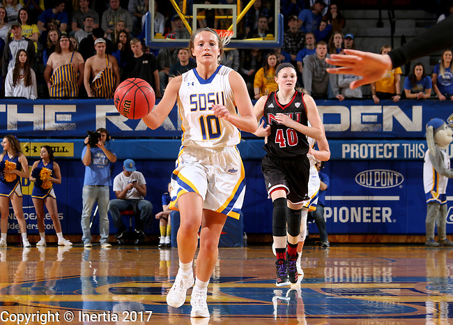 BROOKINGS, SD - MARCH 16:  Kerri Young #10 from South Dakota State University pushes the ball against Northern Illinois during their first round WNIT game Thursday at Frost Arena in Brookings.(Photo by Dave Eggen/Inertia)