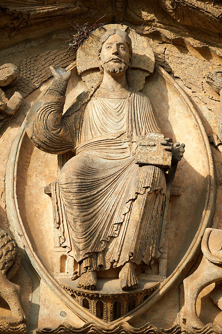West Facade, Central Portal Tympanum - General View c. 1145. Cathedral of Chartres, France . The tympanum shows gothic sculptures of Jesus Christ in Majesty surrounded by the four Evangelist Symbols. A UNESCO World Heritage Site.