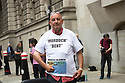 Pic shows: Former News of the World photographer Ian Cutler protests against Murdoch outside the trial<br /> t
