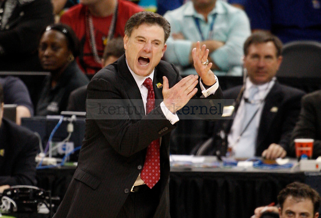 Louisville head coach Rick Pitino calls a timeout during the end of the second half of the UK vs. Louisville National Semi-finals at the Super Dome in New Orleans, Louisiana  March 31, 2012.. Photo by Brandon Goodwin | Staff