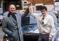 Promoter Barney Eastwood with his boxing protege, Barry McGuigan, pose in front of Eastwood&rsquo;s Rolls Royce in Belfast, N Ireland, UK, November, 1982, 198211000224B<br /> <br /> Copyright Image from Victor Patterson, 54 Dorchester Park, <br /> Belfast, UK, BT9 6RJ<br /> <br /> t1: +44 28 9066 1296 (from Rep of Ireland 048 9066 1296)<br /> t2: +44 28 9002 2446 (from Rep of Ireland 048 9002 2446)<br /> m: +44 7802 353836<br /> <br /> victorpatterson@me.com<br /> www.victorpatterson.com<br /> <br /> Please see my Terms and Conditions of Use at VICTORPATTERSON.COM. It is IMPORTANT that you familiarise yourself with them.<br /> <br /> Images used on the Internet must be visibly watermarked i.e. &copy;VICTORPATTERSON.COM within the body of the image and copyright metadata must not be deleted. Images used on the Internet have a size restriction of 4kbs and are chargeable at the then current NUJ rates.<br /> <br /> This image is only available for the use of the download recipient i.e. television station, newspaper, magazine, book publisher, etc, and must not be passed on to any third party. It is also downloaded on condition that each and every usage is notified within 7 days to victorpatterson@me.com<br /> <br /> The right of Victor Patterson to be identified as the author is asserted in accordance with The Copyright Designs And Patents Act (1988).