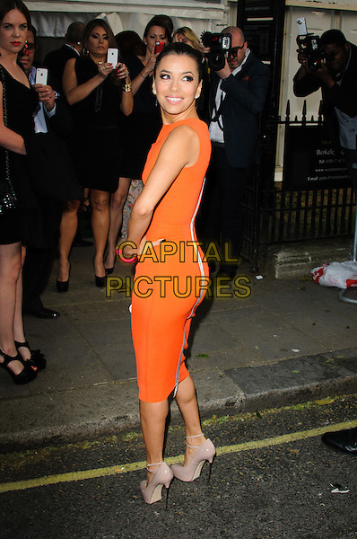 Eva Longoria.Women Of The Year 2012 - Glamour Awards, Berkeley Square, London, England..29th May 2012.full length orange sleeveless dress hand on hip looking over shoulder .CAP/CJ.©Chris Joseph/Capital Pictures.