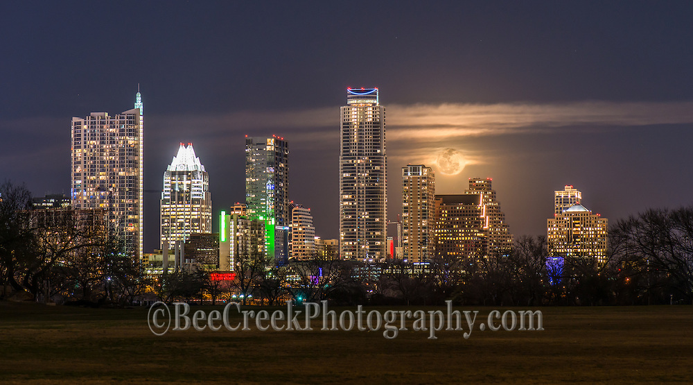 The moon rose over the downtown austin skyline and we captured it right before it went behind the clouds, which cast an spooky look over the city.  You can see the traditional iconic high rises like the Frost, 360 and Austonian from this angle.