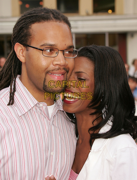 "OMAROSA MANIGAULT-STALLWORTH & HUSBAND.The World Premiere of ""Dodgeball:A True Underdog Story"", Westwood, California.June 14th, 2004.headshot, portrait, smiling, laughing.www.capitalpictures.com.sales@capitalpictures.com.©Capital Pictures"
