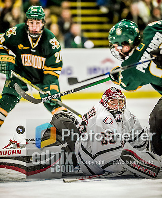 17 October 2015: University of Nebraska Omaha Maverick Goaltender Evan Weninger, a Freshman from Saskatoon, Saskatchewan, watches a second period shot go wide during play against the University of Vermont Catamounts at Gutterson Fieldhouse in Burlington, Vermont. The Mavericks defeated the Catamounts 3-1 in the second game of their weekend series. Mandatory Credit: Ed Wolfstein Photo *** RAW (NEF) Image File Available ***
