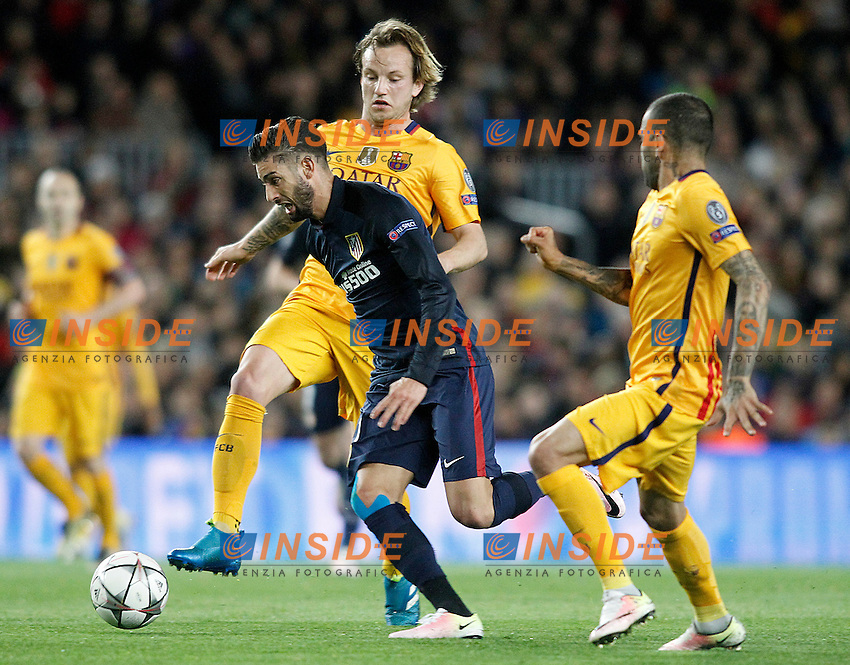 FC Barcelona's Ivan Rakitic (l) and Dani Alves (r) and  Atletico de Madrid's Yannick Carrasco during Champions League 2015/2016 match. April 5,2016. (ALTERPHOTOS/Acero) <br /> Barcellona 05-04-2016 <br /> Football Calcio 2015/2016 Champions League <br /> Barcellona - Atletico Madrid Quarti di finale<br /> Foto Alterphotos / Insidefoto <br /> ITALY ONLY