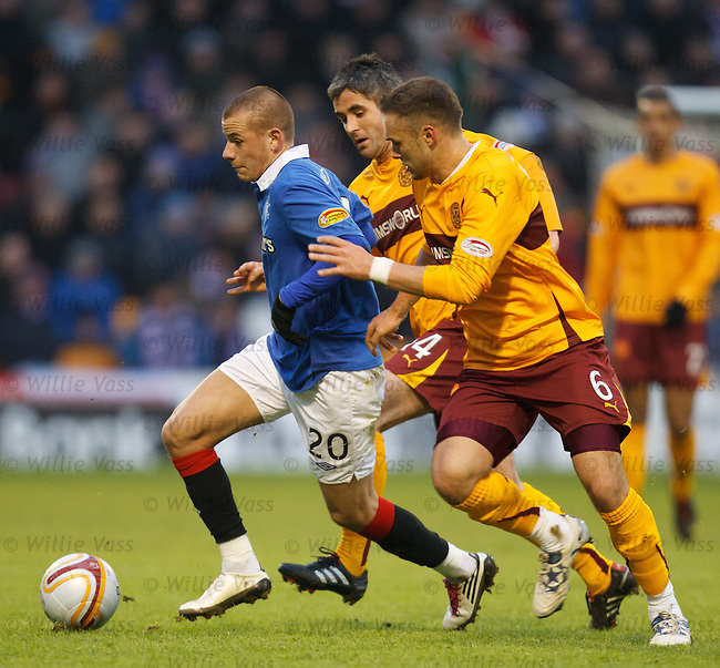 Vladimir Weiss takes off leaving Tom Hateley and Keith Lasley in his wake