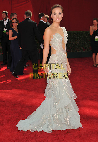 OLIVIA WILDE .Attending the 61st Annual Primetime Emmy Awards held at NOKIA Theatre L.A. LIVE, Los Angeles, California, USA, .20th September 2009..arrivals emmys full length Marchesa silver pale grey gray white tiered lace tulle sheer see through clutch bag cut out away side long maxi layered one shoulder .CAP/ADM/BP.©Byron Purvis/Admedia/Capital Pictures
