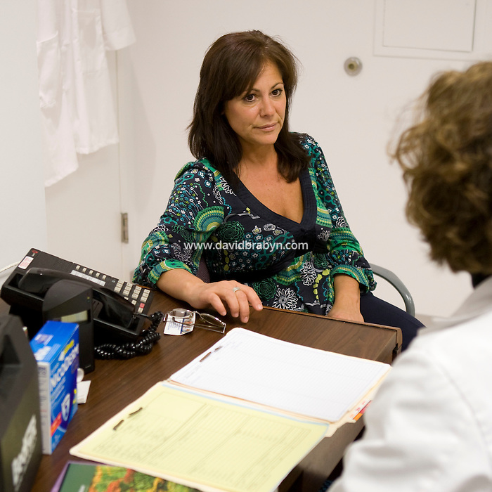 Employee and former smoker Marianna Labella (L) talks to nurse practitioner Mary Sullivan during an appointment in the health center at the Pitney Bowes headquarters in Stamford, CT, United States, 7 October 2008.