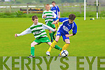 Listowel Celtics Cillian Langan tackles Conor Standen of Killorglin last Saturday in Pat Kennedy Park.