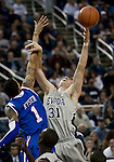 March 3, 2012:   Nevada Wolf Packs Olek Czyz fights for a rebound against the Louisiana Tech Bulldogs Michale Kyser during their NCAA basketball game played at Lawlor Events Center on Saturday night in Reno, Nevada.